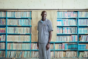 Mbola in the Library at Naivasha Maximum Prison, Kenya, by Jack Lawson 'Mbola is serving time in Naivasha Maximum Prison, a couple of hours' drive from Nairobi,' says Lawson. 'He is working with the African Prisons Project [now called Justice Defenders] as a paralegal, helping other inmates with legal matters such as appeals'