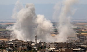 Plumes of smoke rise following a reported attack by Syrian government forces in the southern countryside of the jihadist-held Idlib province