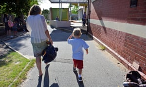 Mother and son walking to school
