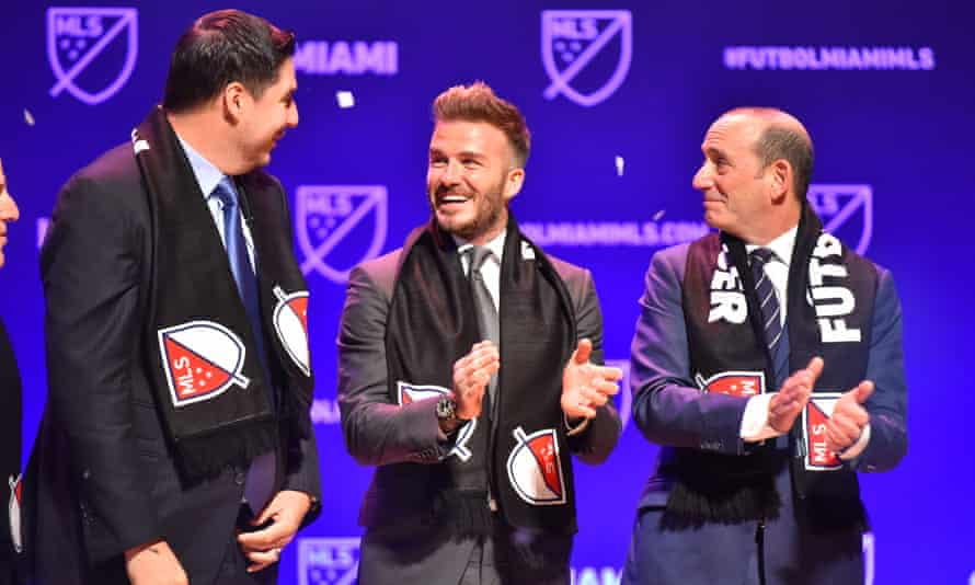 David Beckham with MLS Don Garber (right) after MLS awarded Miami a franchise in 2018