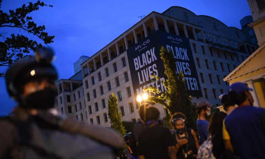 Protesters and police gather at Lafayette Square, in front of the White House in Washington DC, on 22 June.