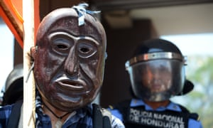 An indigenous man takes part in a protest to claim justice after the murder of activist leader Berta Cáceres.