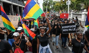 Protesters march on Saturday against the government's response to the oil spill disaster in Port Louis, Mauritius.
