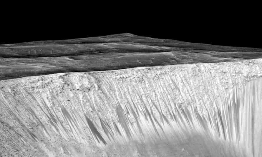 Dark narrow streaks called recurring slope lineae emanate out of the walls of Garni crater on Mars.