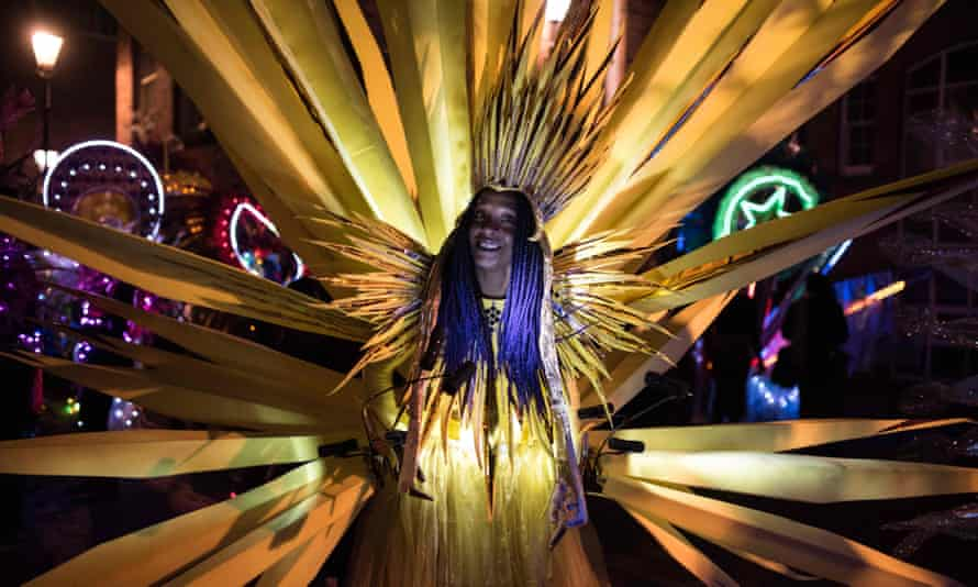 Performers prepare to take part in the Illuminated Night Carnival Parade which features in the annual 'Light Night Leeds' festival of visual arts in the centre of Leeds, northern England on October 5, 2017.