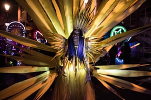 Leeds, UK. Performers take part in the Illuminated Night carnival parade, part of the city's annual Light Night Leeds festival