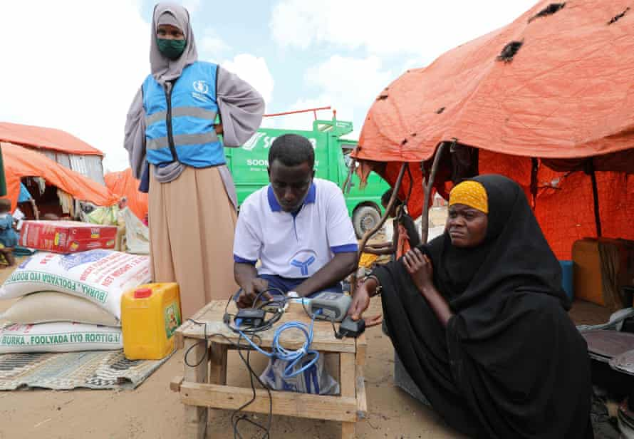 Isha Hassan Abdinur orders online shopping from the World Food Programme in Daynile, Mogadishu.