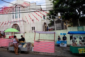 """20/01/2019: Camila Camarjo, 28, and Igor Silva, 30, work with the World Mosquito Program as scientific communicators. On the day of Saint Sebastian, the patron saint of Rio de Janeiro, they have a stand to explain to people the Wolbachia method of control. Igor says: """"For me it's more than just a job, it's a battle for a better future."""" But lots of people ask him: """"We already have so many mosquitoes, why add more?"""""""