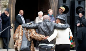 Mourners dance to reggae music outside St Agnes Church in St Paul
