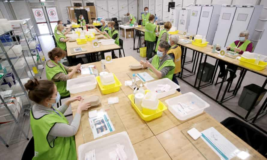 Medical workers prepare doses of the Oxford/AstraZeneca jab at a vaccination centre in Antwerp, Belgium