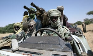 Fighters drive an armoured truck near the Sudan-Chad border.