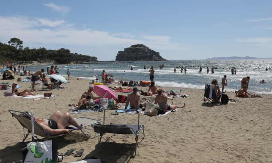 People on a beach at Bormes-les-Mimosas in the south of France a few days after the country was added to the FCO travel quarantine list.