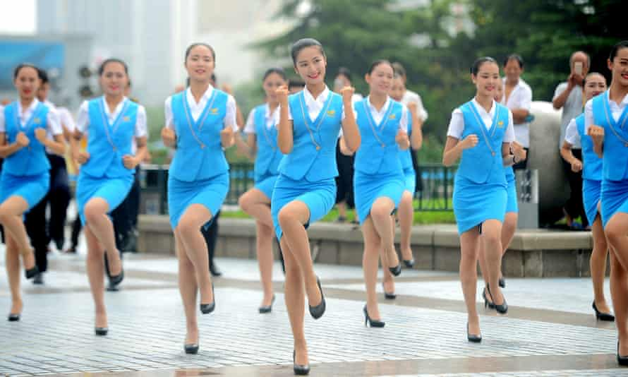 Flashmob by trainee air hostesses, Ji'nan, Shandong province, China - 08 Aug 2016