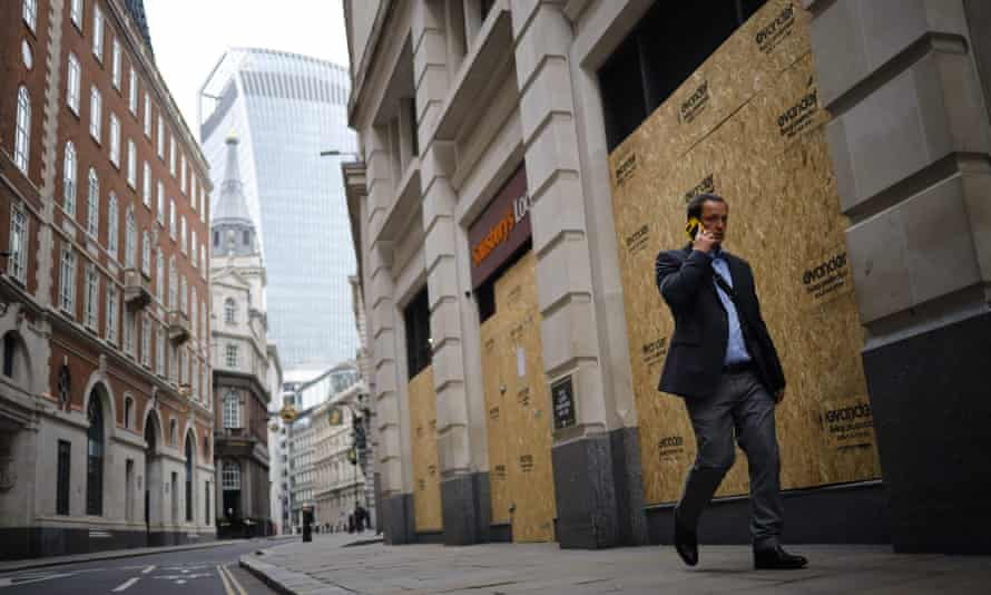 A man walks through a near-deserted City of London