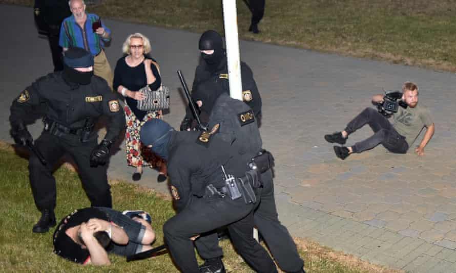 Riot police detain a demonstrator in Minsk on Sunday.