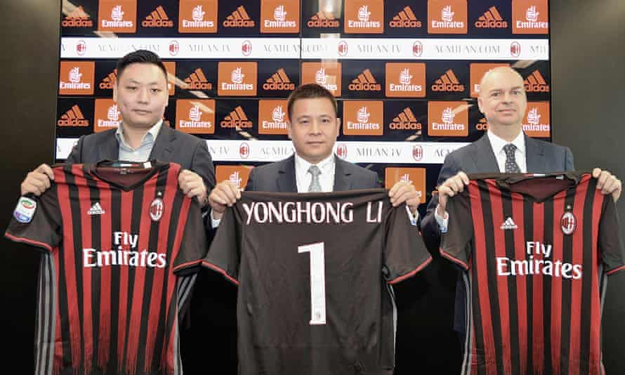 New Milan board member Li David Han, left, owner and president Li Yonghong, centre, and CEO Marco Fassone during a press conference on 14 April 2017.
