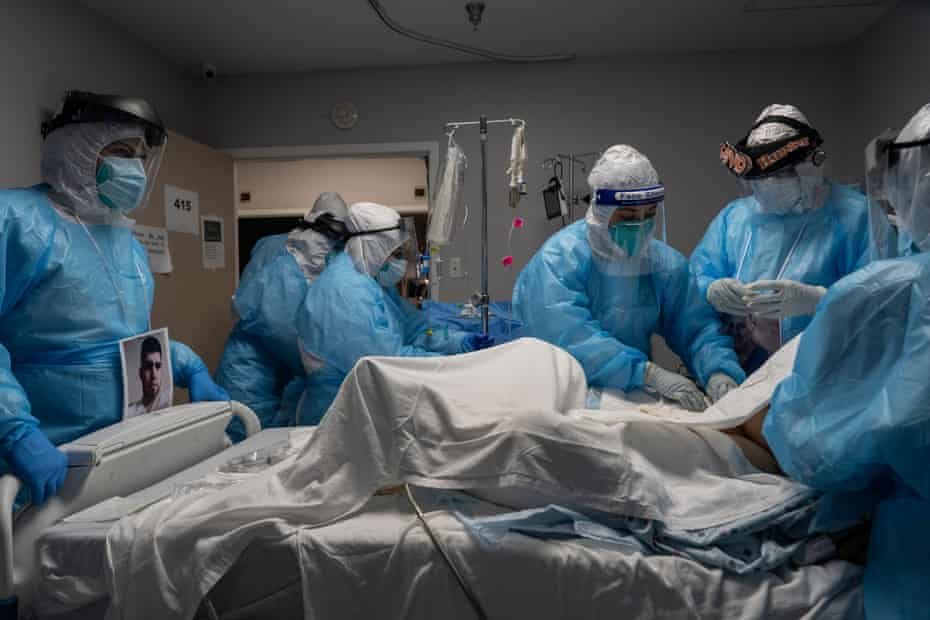 Medical staff members treat a patient suffering from the coronavirus disease (COVID-19) in the COVID-19 intensive care unit (ICU) at the United Memorial Medical Center (UMMC) on October 31, 2020 in Houston, Texas. According to reports, Texas has reached over 916,000 cases, including over 18,000 deaths.