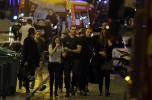 Rescuers evacuate people following an attack at the Bataclan bar in Paris, 13 November 2015.