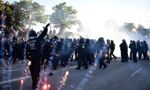 Police and protesters clash.