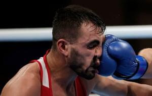 Aliaksandr Radzionau of Belarus in action against Necat Ekinci of Turkey