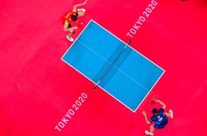 Manika Batra (left) of India serves during her table tennis women's singles first-round win over Britain's Tin-Tin Ho.