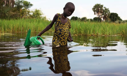 An internally displaced girl collects water in the Sudd swamp in South Sudan.
