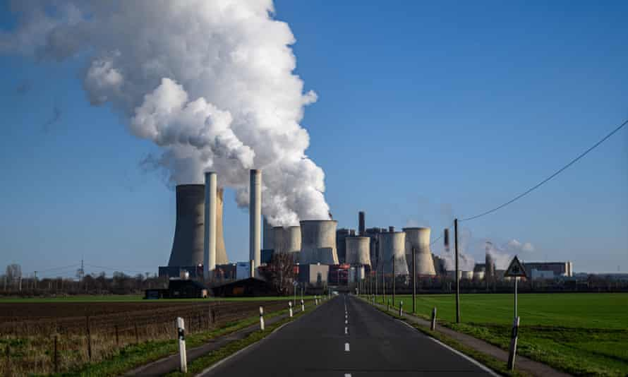 Steam rises from cooling towers at a coal-fired power plant near Bergheim, Germany.