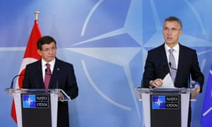 Davutoğlu and the Nato secretary general, Jens Stoltenberg, give a press briefing in Brussels.