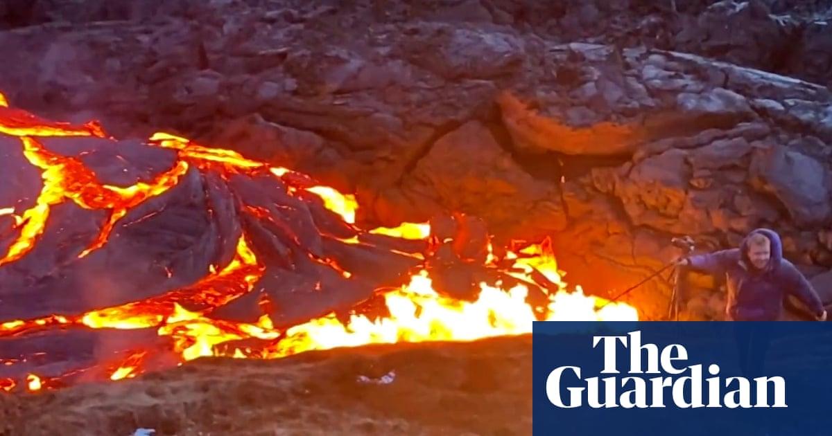 Iceland volcano: photographer runs away as lava flows towards him – video