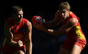 Tom Lynch (right) and Sam Day of Gold Coast Suns in action against Carlton Blues at Etihad Stadium in Melbourne.
