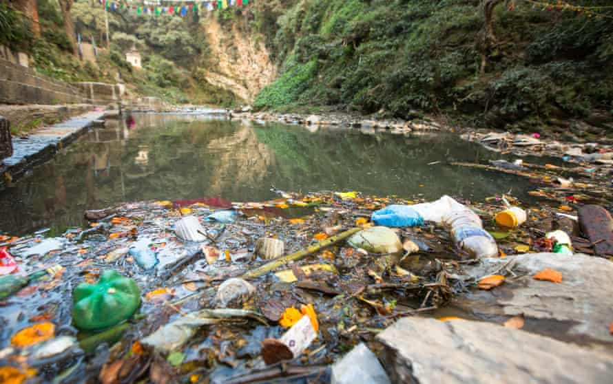 Garbage and bottles floating on waterPlastic Contamination into Nature. Environmental pollution in the Himalayas. Garbage in the water of river Bagmati.