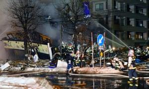 Firefighters attend the scene in Sapporo.
