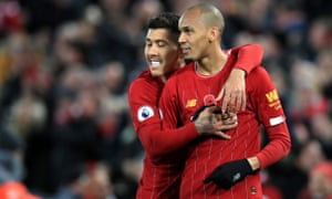 Fabinho, right, celebrates his spectacular goal that set the tone for Liverpool's convincing victory.