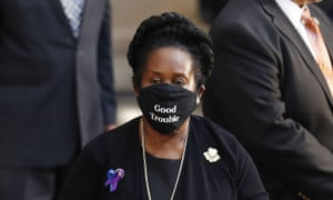 The Texas congresswoman Sheila Jackson wears a 'Good Trouble' face mask in the Rotunda of the US Capitol.