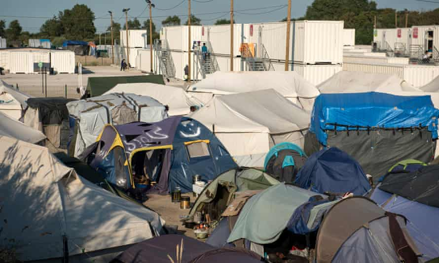 The tents and white metal containers housing refugees in Calais.