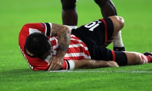Charlie Austin lies on the ground with an injury