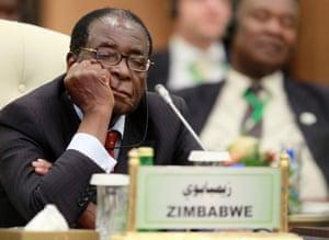 2010: Robert Mugabe sleeps during a speech by Libyan leader Muammar Gaddafi at the start of the third EU-Africa summit in Tripoli, 29 November