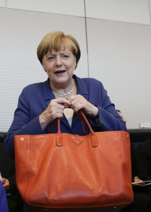 German Chancellor Angela Merkel arrives for a special meeting of the Christian Democratic Union (CDU) party faction on the eve of a special session of the parliament Bundestag about negotiations with Greece for a new bailout in Berlin, Germany, Thursday, July 16, 2015..(AP Photo/Markus Schreiber)