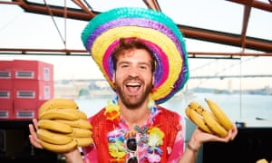 a partygoer holding bunches of bananas