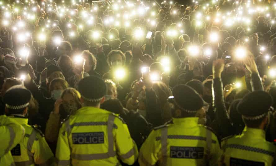 Police officers face the crowd during a vigil for Sarah Everard in Clapham Common