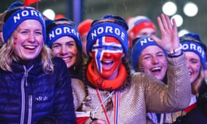 Norwegian fans celebrate their team's gold medal in the men's cross-country relay