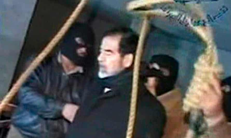 Television footage shows masked executioners prepare to execute former Iraqi president Saddam Hussein.