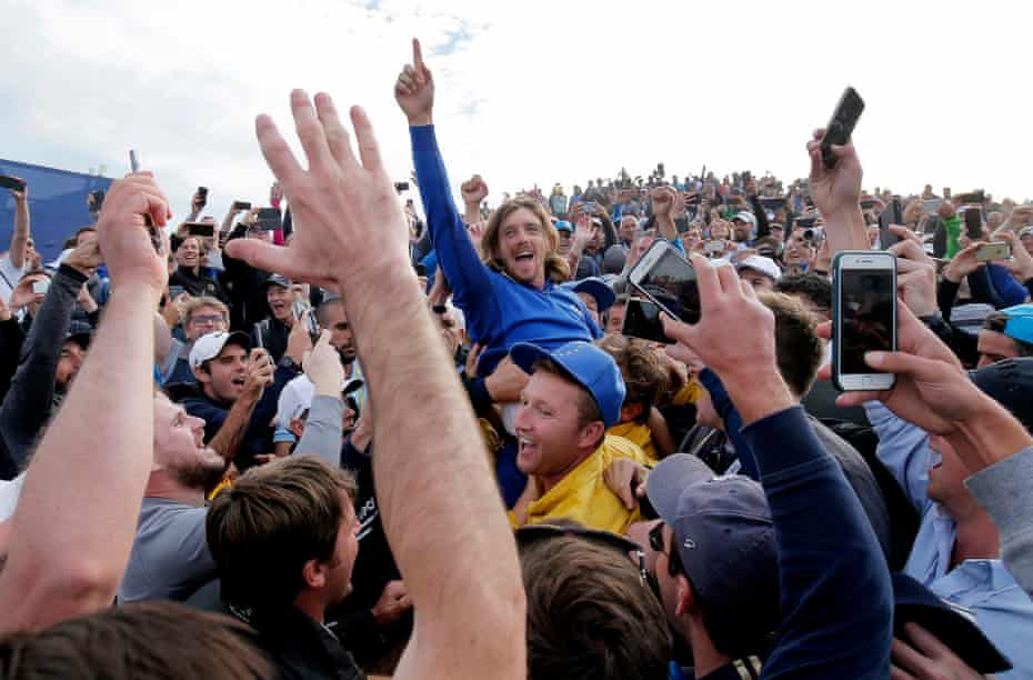 Tommy Fleetwood is chaired by fans near the 16th tee as Europe celebrate their victory during day three of the 2018 Ryder Cup