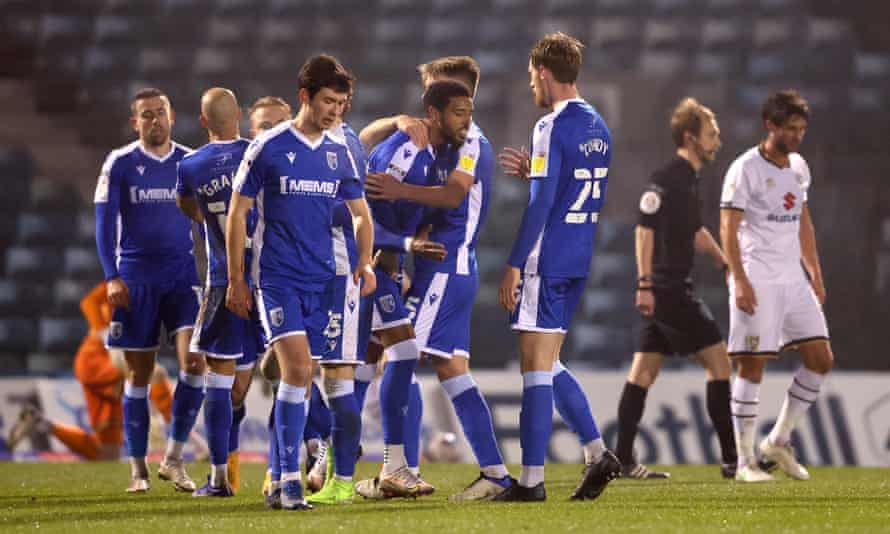 Gillingham celebrate a goal against Milton Keynes Dons last month. 'I don't like agents. I don't like their business, their trade,' says the club's owner, Paul Scally.