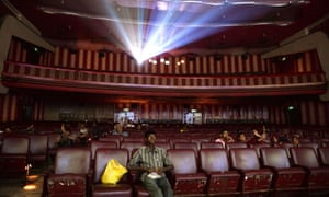 Indian cinemagoers watch a screening of a Bollywood film.