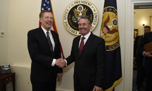 Liam Fox (right) and the US trade representative Robert Lighthizer shake hands before the first trade working group in Washington on Monday.