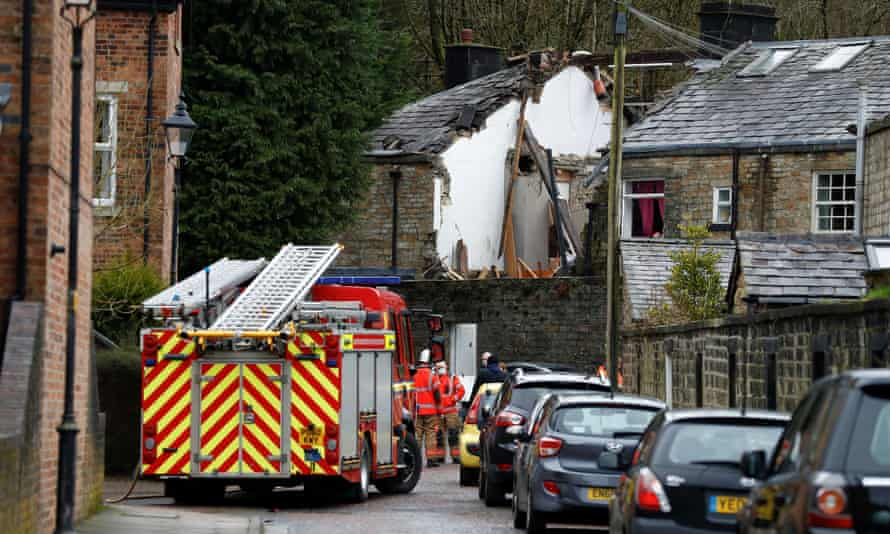 Firefighters stand at the scene of a collapsed house in Summerseat, Ramsbottom.