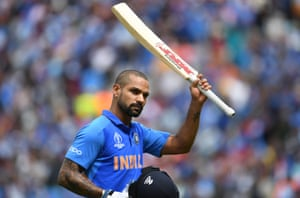 Dhawan raises his bat as he receives a standing ovation from the crowd as he walks back to the pavilion after his dismissal.