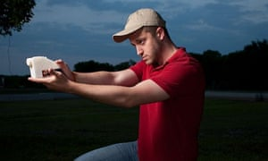 Cody Wilson poses with a 'Liberator' 3D-printed gun.