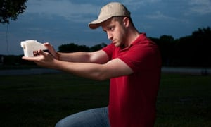 Cody Wilson demonstrates with a 3D-printed gun.